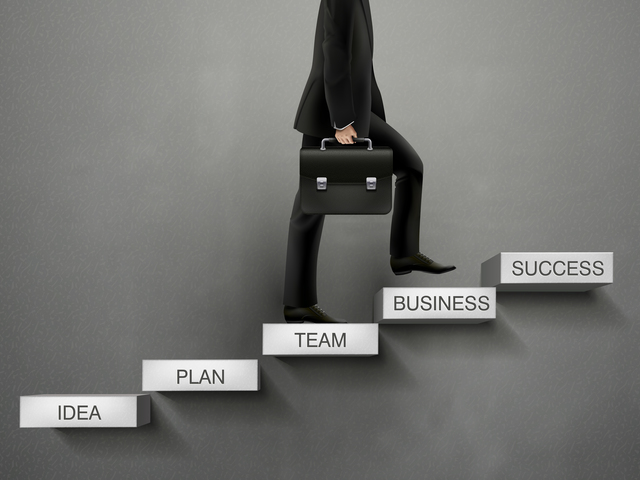 businessman going up to the success way