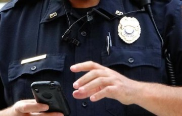 Officer Holding Cell Phone